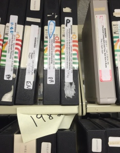 "3/4"" videotapes on a shelf"