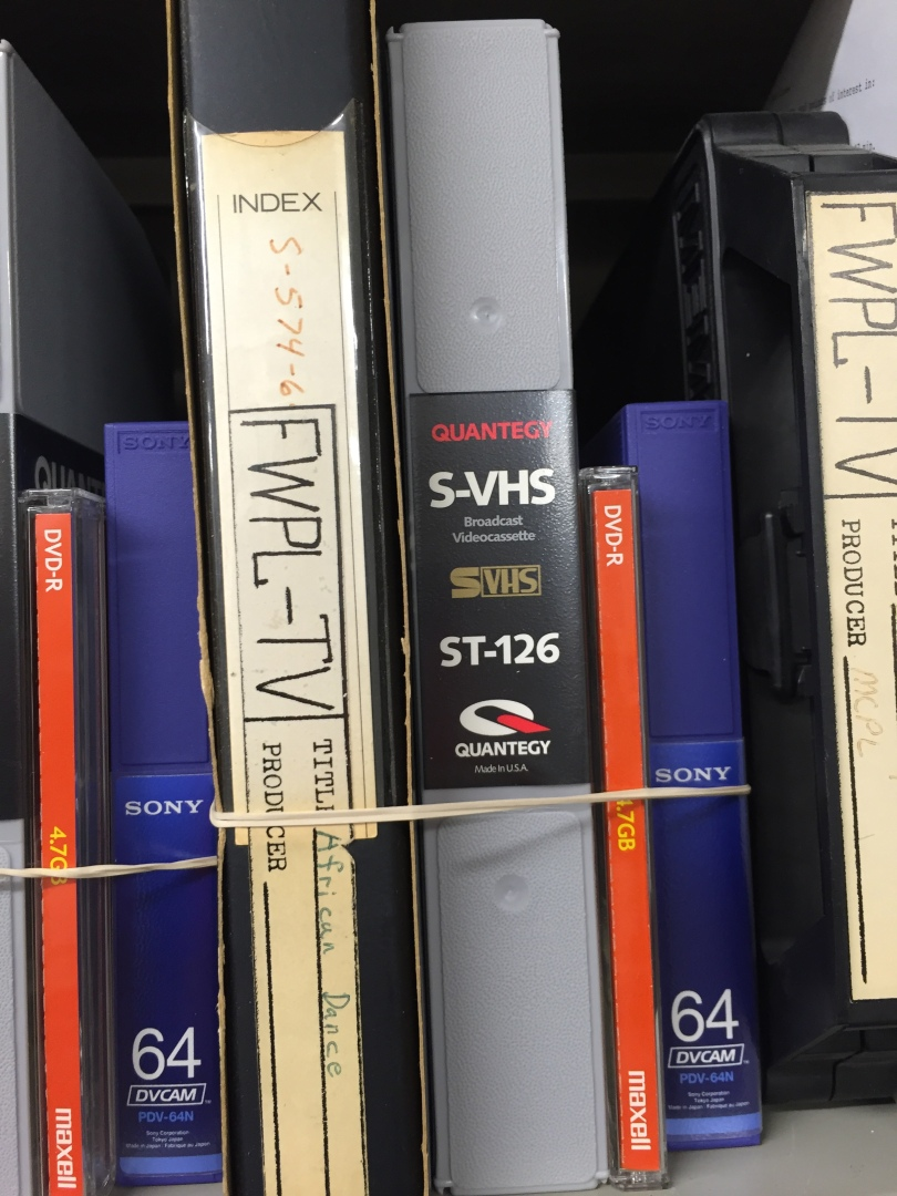 Very old, open reel tapes rubber-banded to formats from a 2000 era digitization project.